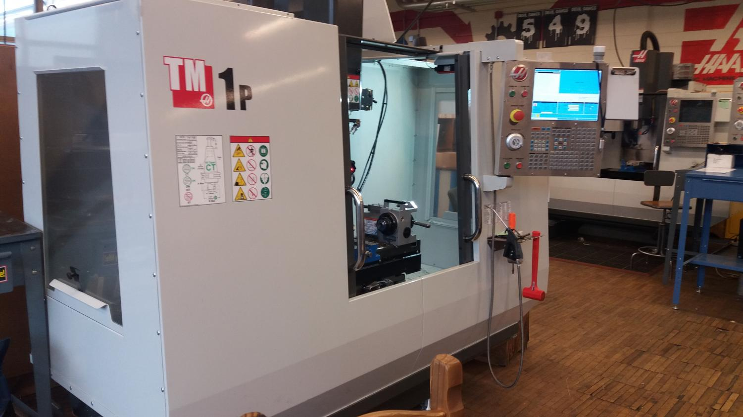 One of the CNC milling machines that the shop will be receiving eight more of