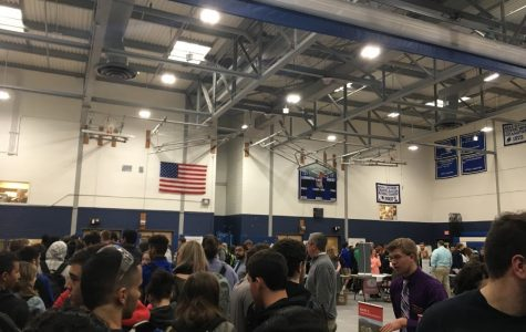 Students fill the gym to find out about local colleges.