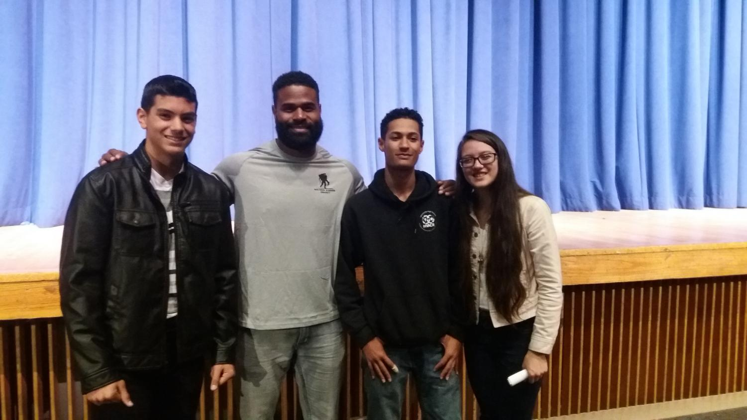 Former NFL running back William Green(second from the left) stands with LHS FCA members (In order from left) Junior Dan Garcia, Junior Lucrecia Acosta, and Junior Damian Regalado.