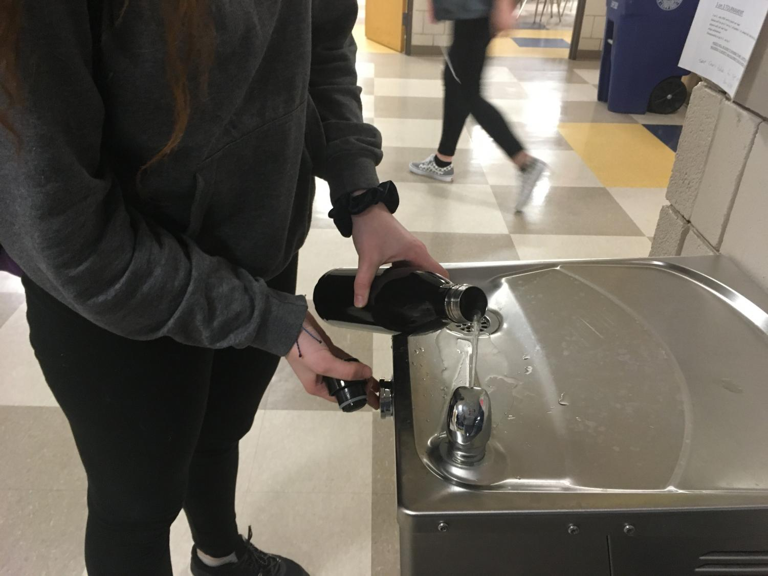 LHS Senior Megan Caless filling her water bottle from a bubbler at LHS