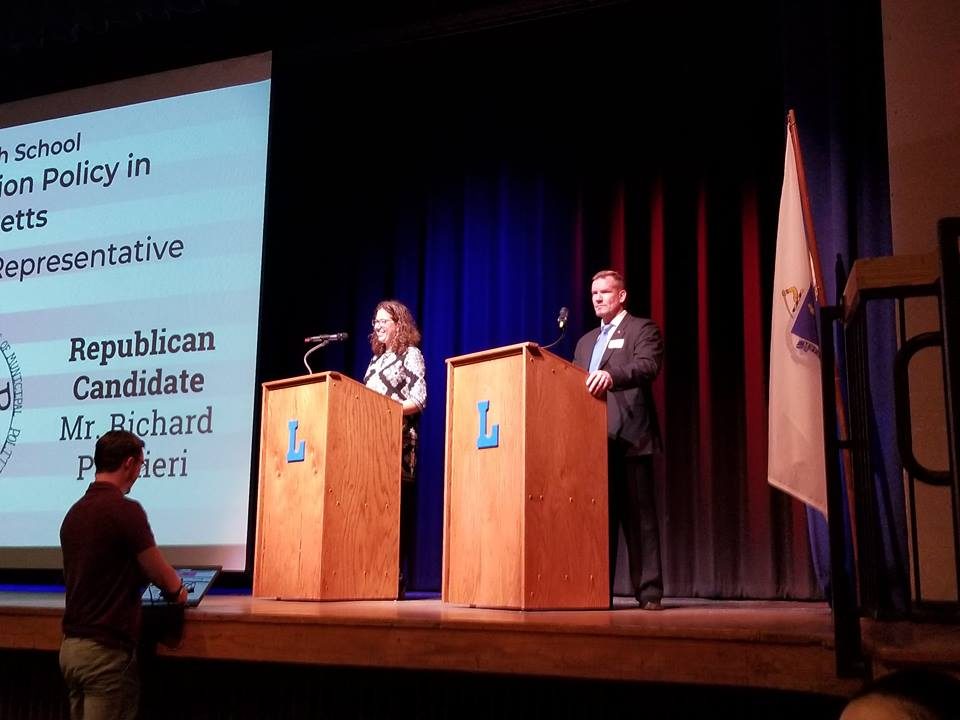 Natalie Higgins (left) debates Richard Palmieri (right) at LHS