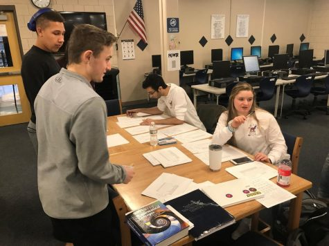 LHS Seniors Jaydon Kinuthia and Bryce Vitone register to vote with the help of STUMP students  LHS juniors Michael Fahim and Aleyna Duval