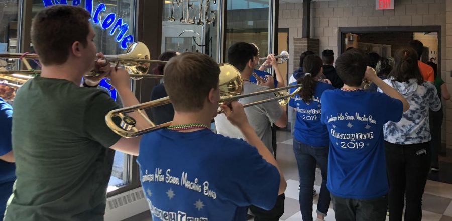 LHS Marching Band celebrates Mardis Gras with a tribute through the halls of LHS