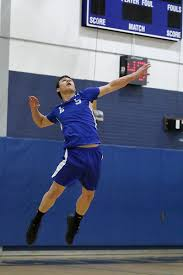 Leominster High School senior Eric Jenny serves the ball at the game against South Lancaster.