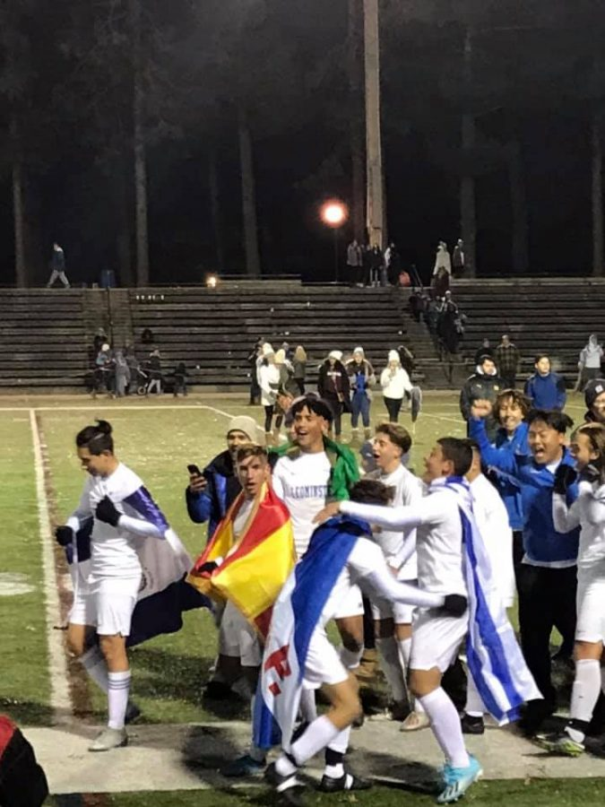 The Leominster Boys Soccer Team celebrates on the field after winning the Division 1 Cedntral Mass District  Game at Doyle Field